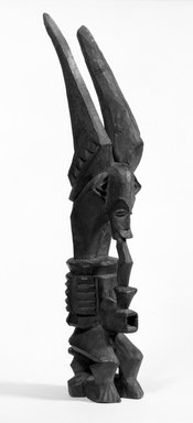 Igbo (northern). <em>Figure (Ikenga)</em>, early 20th century. Wood, 16 x 3 x 4 in. (40.3 x 7.8 x 10.2 cm). Brooklyn Museum, Gift of Dr. Ernst Anspach, 75.147.2. Creative Commons-BY (Photo: Brooklyn Museum, 75.147.2_bw.jpg)