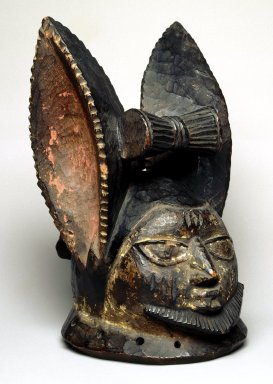 Yorùbá. <em>Helmet mask (ère egúngún)</em>, late 19th or early 20th century. Wood, pigment, ferrous nails, H: 11 1/2 in. (29.2 cm). Brooklyn Museum, Gift of Dr. and Mrs. Abbott A. Lippman, 75.149.1. Creative Commons-BY (Photo: Brooklyn Museum, 75.149.1_SL1.jpg)