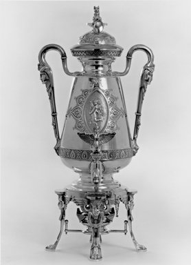 J. E. Caldwell & Co. (founded 1839). <em>Urn with Cover, Figure on Spigot, Stand and Fuel Lamp</em>, ca. 1875. Sterling silver, ivory, Overall height of unit: 20 13/16 in. (52.9 cm). Brooklyn Museum, H. Randolph Lever Fund, 75.164.1a-e. Creative Commons-BY (Photo: Brooklyn Museum, 75.164.1a-e_Design_scan_bw.jpg)