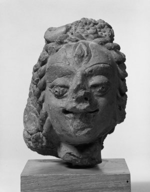 <em>Head of a Shiavite Deity</em>. Red terracotta, 5 1/8 x 3 3/8 x 4 15/16 in. (13 x 8.5 x 12.5 cm). Brooklyn Museum, Gift of Paul F. Walter, 75.177. Creative Commons-BY (Photo: Brooklyn Museum, 75.177_bw.jpg)