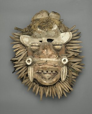 We. <em>Mask (Von Gla)</em>, late 19th or early 20th century. Wood, metal, fur, fiber, hair, leopard's teeth, pigment, 18 x 15 3/4 x 6 in. (45.7 x 40 x 15.2 cm). Brooklyn Museum, Gift of Mr. and Mrs. J. Gordon Douglas III, 75.189.4. Creative Commons-BY (Photo: Brooklyn Museum, 75.189.4_PS1.jpg)