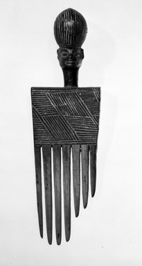 Chokwe. <em>Comb</em>, 20th century. Wood, 6 x 1 3/4 x 1 1/2 in. (15.3 x 4.5 x 3.5 cm). Brooklyn Museum, Gift of Mr. and Mrs. John McDonald, 75.193.1. Creative Commons-BY (Photo: Brooklyn Museum, 75.193.1_bw.jpg)