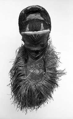 Pende (Western). <em>Mask (Mbuya) with Long Beard (Kinoyo-Muyombo)</em>, late 19th-early 20th century. Wood, fiber, raffia, pigment, 24 1/2 x 10 1/2 x 5 1/2 in. (62.2 x 26.7 x 14.0 cm). Brooklyn Museum, Gift of Mr. and Mrs. John McDonald, 75.193.2. Creative Commons-BY (Photo: Brooklyn Museum, 75.193.2_bw.jpg)