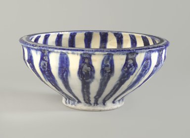 <em>Blue and White Bowl with Radial Design</em>, 13th century. Ceramic; fritware, painted in cobalt blue under a transparent glaze, 3 11/16 in. (9.3 cm). Brooklyn Museum, Gift of Mr. and Mrs. Thomas S. Brush, 75.2. Creative Commons-BY (Photo: Brooklyn Museum, 75.2_view1_PS6.jpg)