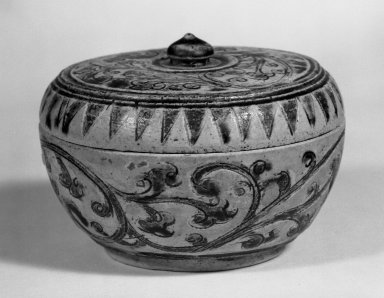 <em>Sawankhalok Covered Box with Cover</em>, 14th century. Stoneware, clay, 2 3/4 x 3 7/8 in. (7 x 9.8 cm). Brooklyn Museum, Designated Purchase Fund, 75.32.2a-b. Creative Commons-BY (Photo: Brooklyn Museum, 75.32.2a-b_bw.jpg)