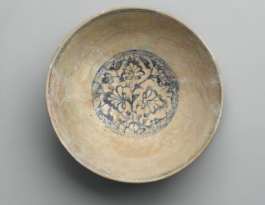 <em>Bowl with Lotus Blossoms</em>, 15th century. Ceramic; fritware, painted in cobalt blue under a transparent glaze; some iridescence, 4 x 8 5/8 in. (10.2 x 21.9 cm). Brooklyn Museum, Designated Purchase Fund, 75.56. Creative Commons-BY (Photo: Brooklyn Museum, 75.56_top_PS2.jpg)
