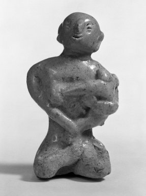 <em>Sawankhalok Cedadon Maternity Figure Seated on Floor</em>, 14th century. Stoneware, 3 7/16 x 2 1/8 in. (8.7 x 5.4 cm). Brooklyn Museum, Designated Purchase Fund, 75.62.8. Creative Commons-BY (Photo: Brooklyn Museum, 75.62.8_bw.jpg)
