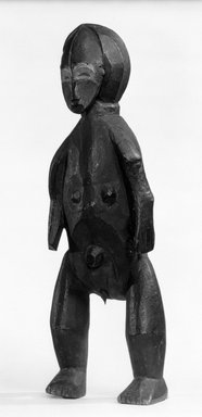 Zande. <em>Standing Female Figure</em>, late 19th-early 20th century. Wood, pigment, metal, 19 5/8 x 6 1/2 x 6 in. (49.8 x 16.5 x 15.3 cm). Brooklyn Museum, Purchased with funds given by Evelyn A. Jaffe Hall Charitable Trust, 75.75.3. Creative Commons-BY (Photo: Brooklyn Museum, 75.75.3_bw.jpg)