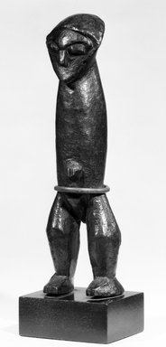 Zande. <em>Yanda Figure (Nazeze Type)</em>, late 19th or early 20th century. Wood, copper alloy, 7 1/8 x 2 x 1 3/4 in. (18.2 x 4.9 x 4.3 cm). Brooklyn Museum, Purchased with funds given by Evelyn A. Jaffe Hall Charitable Trust, 75.75.4. Creative Commons-BY (Photo: Brooklyn Museum, 75.75.4_bw.jpg)