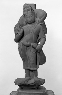 <em>Attendant Deity</em>, 11th century. Reddish sandstone, 19 1/8 x 6 3/4 in. (48.6 x 17.1 cm). Brooklyn Museum, Gift of Hon. and Mrs. Leon Polsky, 76.113. Creative Commons-BY (Photo: Brooklyn Museum, 76.113_bw.jpg)