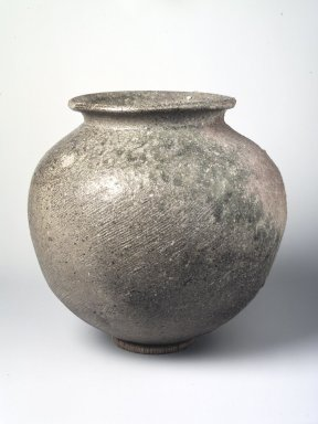 <em>Jar</em>, 5th-6th century. Sue ware: coil-built, gray stoneware with ash glaze, 10 1/8 x 10 in.  (25.7 x 25.4 cm). Brooklyn Museum, Frank L. Babbott Fund, Henry L. Batterman Fund, Contributions Fund, Caroline A.L. Pratt Fund, and Charles Stewart Smith Memorial Fund, 76.118. Creative Commons-BY (Photo: Brooklyn Museum, 76.118_transp6293.jpg)