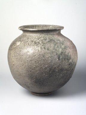<em>Jar</em>, 5th-6th century. Sue ware: coil-built, gray stoneware with ash glaze, 10 1/8 x 10 in.  (25.7 x 25.4 cm). Brooklyn Museum, Frank L. Babbott Fund, Henry L. Batterman Fund, Contributions Fund, Caroline A.L. Pratt Fund, and Charles Stewart Smith Memorial Fund, 76.118. Creative Commons-BY (Photo: Brooklyn Museum, 76.118_transp6293.jpg)