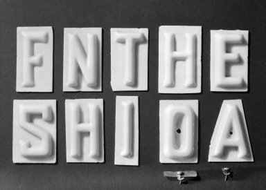 "American. <em>Theater Marquee Alphabet Letter ""T,""</em> ca. 1925. Milk glass, 4 5/8 x 3 3/4 in. (11.7 x 9.5 cm). Brooklyn Museum, Gift of Barbara Head Millstein, 76.141.10. Creative Commons-BY (Photo: , 76.141.1-10_bw.jpg)"