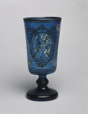 <em>Wine Goblet</em>, mid-19th century. Translucent deep blue glass; free blown and enameled; tooled on the pontil, 6 x 3 in. (15.2 x 7.6 cm). Brooklyn Museum, Gift of Mr. and Mrs. Charles K. Wilkinson in honor of Irma L. Fraad, 76.147.3. Creative Commons-BY (Photo: Brooklyn Museum, 76.147.3_SL1.jpg)