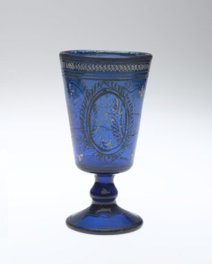 <em>Wine Goblet</em>, mid-19th century. Translucent deep blue glass; free blown and enameled; tooled on the pontil, 5 13/16 x 2 11/16 in. (14.8 x 6.9 cm). Brooklyn Museum, Gift of Mr. and Mrs. Charles K. Wilkinson in honor of Irma L. Fraad, 76.147.4. Creative Commons-BY (Photo: Brooklyn Museum, 76.147.4_side1_PS2.jpg)