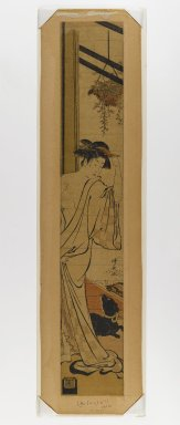 Torii Kiyonaga (Japanese, 1752-1815). <em>Woman after the Bath and Dog</em>, c. 1781. Woodblock Print, 27 3/8 x 4 5/8 in. (69.5 x 11.7 cm). Brooklyn Museum, Anonymous gift, 76.151.35 (Photo: Brooklyn Museum, 76.151.35_IMLS_PS4.jpg)