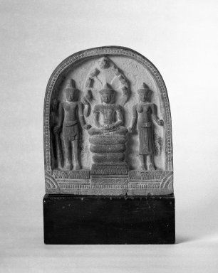 <em>Architectural Element from a Temple: Scene of Buddha Mucalinda and Attendants</em>, 12th-13th century. Sandstone, Lopuri style?, 9 3/4 x 17 1/8 in. (24.8 x 43.5 cm). Brooklyn Museum, Gift of Martha M. Green, 76.179.1. Creative Commons-BY (Photo: Brooklyn Museum, 76.179.1_bw.jpg)