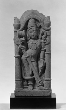 <em>Architectural Fragment Depicting Shiva in a Pillared Niche</em>, ca. 12th-13th century. Sandstone, 23 x 9 1/2 in. (58.4 x 24.1 cm). Brooklyn Museum, Gift of Martha M. Green, 76.179.2. Creative Commons-BY (Photo: Brooklyn Museum, 76.179.2_bw.jpg)