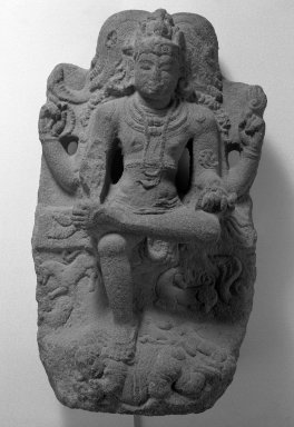 <em>Dakshimarmurti</em>, 10th-11th century. Granite stone, 33 x 18 1/2 in. (83.8 x 47 cm). Brooklyn Museum, Gift of Martha M. Green, 76.179.7. Creative Commons-BY (Photo: Brooklyn Museum, 76.179.7_bw.jpg)