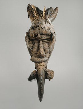 Mau. <em>Koma Ba Mask</em>, late 19th-early 20th century. Wood, cowrie shells, metal, feathers, horns, leather, fiber, sacrificial materials, 41 x 11 x 11 in. (104.1 x 27.9 x 27.9 cm). Brooklyn Museum, Gift of Marcia and John Friede, 76.20.2. Creative Commons-BY (Photo: Brooklyn Museum, 76.20.2_SL1.jpg)