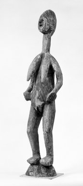 Mossi. <em>Figure of a Female (Ninana)</em>, late 19th-early 20th century. Wood, 37 x 8 3/4 x 6 1/2 in. (94.0 x 22.2 cm). Brooklyn Museum, Gift of Marcia and John Friede, 76.20.5. Creative Commons-BY (Photo: Brooklyn Museum, 76.20.5_bw.jpg)