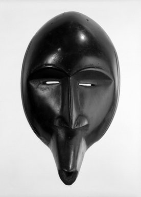 Toura. <em>Mask</em>, late 19th-early 20th century. Wood, 10 5/8 x 6 1/4 in. (27 x 15.9 cm). Brooklyn Museum, Gift of Marcia and John Friede, 76.20.7. Creative Commons-BY (Photo: Brooklyn Museum, 76.20.7_bw.jpg)