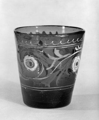 <em>Beaker</em>, 18th century (possibly). Glass, 2 11/16 x 1 3/4 x 2 1/2 in. (6.8 x 4.4 x 6.4 cm). Brooklyn Museum, The C. Helme and Alice B. Strater Collection, Gift of C. Helme Strater, Jr., John B. Strater, and Margaret S. Robinson, 76.34.22. Creative Commons-BY (Photo: Brooklyn Museum, 76.34.22_bw.jpg)