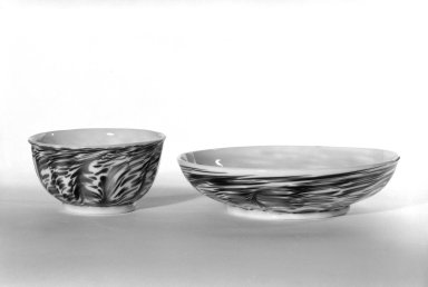 <em>Cup and Saucer</em>, 18th century-?. Glass, 1 3/4 x 3 3/16 in. (4.4 x 8.1 cm). Brooklyn Museum, The C. Helme and Alice B. Strater Collection, Gift of C. Helme Strater, Jr., John B. Strater, and Margaret S. Robinson, 76.34.6a-b. Creative Commons-BY (Photo: Brooklyn Museum, 76.34.6a-b_bw.jpg)