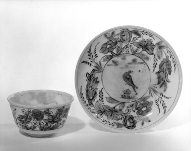 <em>Cup and Saucer</em>, 18th century (possibly). Glass, 1 5/16 x 2 3/4 in. (3.3 x 7 cm). Brooklyn Museum, The C. Helme and Alice B. Strater Collection, Gift of C. Helme Strater, Jr., John B. Strater, and Margaret S. Robinson, 76.34.7a-b. Creative Commons-BY (Photo: Brooklyn Museum, 76.34.7a-b_bw.jpg)