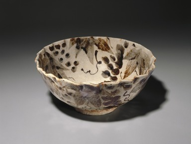 Kitaoji Rosanjin (Japanese, 1883-1959). <em>Bowl with Grape Pattern</em>, ca. 1950. Glazed stoneware, 4 x 9 1/8 in. (10.2 x 23.2 cm). Brooklyn Museum, Gift of Sidney B. Cardozo, Jr. in memory of Eva M. Cardozo, 76.42.1. Creative Commons-BY (Photo: Brooklyn Museum, 76.42.1_SL1.jpg)