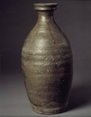 <em>Bottle</em>, late 11th-12th century. Stoneware with celadon glaze, 11 1/2 x 5 3/8 x 2 9/16 in. (29.2 x 13.7 x 6.5 cm). Brooklyn Museum, Gift of Robert Sistrunk, 76.45. Creative Commons-BY (Photo: Brooklyn Museum, 76.45.jpg)