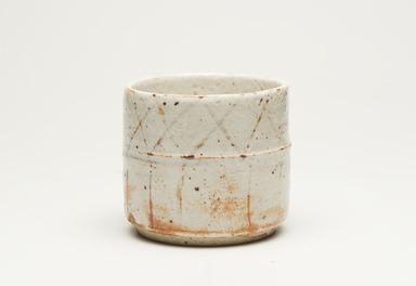 Kitaoji Rosanjin (Japanese, 1883-1959). <em>Cylindrical Vessel</em>, ca. 1955. Stoneware, E-Shino ware, 3 3/4 x 4 1/8 in. (9.5 x 10.5 cm). Brooklyn Museum, Gift of Dr. Hugo Munsterberg, 76.68. Creative Commons-BY (Photo: Brooklyn Museum, 76.68_view01_PS11.jpg)