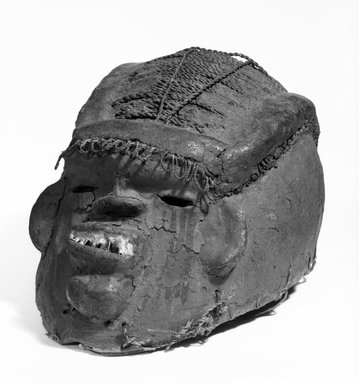 <em>Mask</em>, early 20th century. Gourd, cloth, paint, metal, twine. Brooklyn Museum, Gift of Marcia and John Friede, 76.82.2. Creative Commons-BY (Photo: Brooklyn Museum, 76.82.2_bw.jpg)