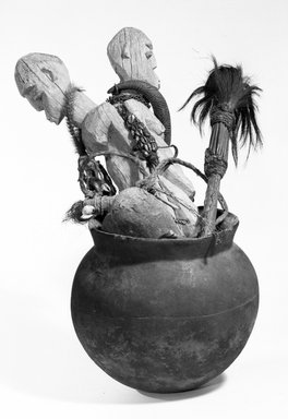 Lobi. <em>Shrine Vessel</em>, late 19th-early 20th century. Ceramic, wood, twine, animal hair and animal hide, shells, metal chain  , height of vessel (a): 10 in. (25.4 cm). Brooklyn Museum, Gift of  Marcia and John Friede, 76.82.3a-d. Creative Commons-BY (Photo: Brooklyn Museum, 76.82.3a-d_bw.jpg)