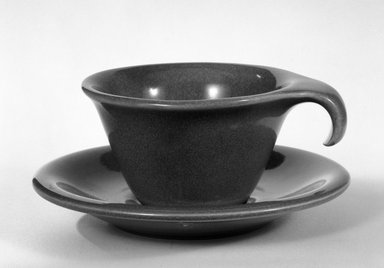Russel Wright (American, 1904-1976). <em>Cup and Saucer</em>, ca. 1945. Glazed china, 2 x 3 1/2 in. (5.1 x 8.9 cm). Brooklyn Museum, Gift of Russel Wright, 76.99.36a-b. Creative Commons-BY (Photo: Brooklyn Museum, 76.99.36a-b_bw.jpg)