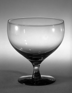 Russel Wright (American, 1904-1976). <em>Drinking Glass</em>, ca. 1940. Transparent glass, 4 1/8 x 3 15/16 in. (10.5 x 10 cm). Brooklyn Museum, Gift of Russel Wright, 76.99.9. Creative Commons-BY (Photo: Brooklyn Museum, 76.99.9_bw.jpg)