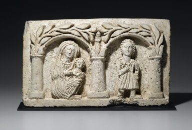 <em>The Holy Family(?)</em>, 20th century (probably). Nummulitic limestone, With mount: 12 x 21 1/16 x 4 in. (30.5 x 53.5 x 10.2 cm). Brooklyn Museum, Gift of Mrs. Jacob M. Kaplan, 77.129. Creative Commons-BY (Photo: Brooklyn Museum, 77.129_PS2.jpg)