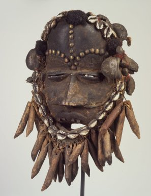 We. <em>Face Mask</em>, late 19th or early 20th century. Wood, cloth, copper alloy, shells, hair, cordage, ferrous nails, accumulated materials, 12 x 8 1/4 x 5 1/4 in. (30.5 x 21 x 13.3 cm). Brooklyn Museum, Gift of Mr. and Mrs. J. Gordon Douglas III, 77.173.4. Creative Commons-BY (Photo: Brooklyn Museum, 77.173.4.jpg)