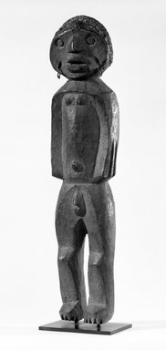 Tiv. <em>Standing Figure</em>, early 20th century. Wood, metal, resin, 21 1/4 x 4 3/4 x 4 1/2 in. (54.0 x 12.2 x 11.5 cm). Brooklyn Museum, Gift of Dr. and Mrs. Abbott A. Lippman, 77.177.1. Creative Commons-BY (Photo: Brooklyn Museum, 77.177.1_front_bw.jpg)