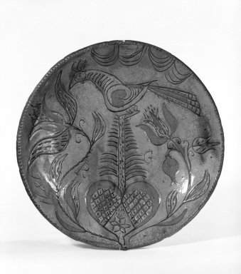 American. <em>Pie Plate</em>, 1811. Earthenware, 1 3/8 x 10 3/8 in. (3.5 x 26.4 cm). Brooklyn Museum, Purchased with funds given by Christine V. Ness, H. Randolph Lever Fund, Alfred T. and Caroline S. Zoebisch Fund, and other funds, 77.191.1. Creative Commons-BY (Photo: Brooklyn Museum, 77.191.1_bw.jpg)