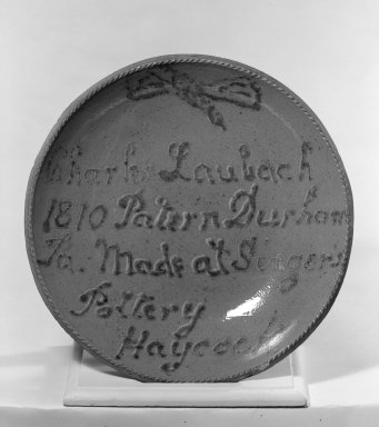 American. <em>Plate</em>, ca. 1888, from an 1810 mold. Earthenware, 2 3/8 x 13 in. (6 x 33 cm). Brooklyn Museum, Purchased with funds given by Christine V. Ness, H. Randolph Lever Fund, Alfred T. and Caroline S. Zoebisch Fund, and other funds, 77.191.3. Creative Commons-BY (Photo: Brooklyn Museum, 77.191.3_bw.jpg)