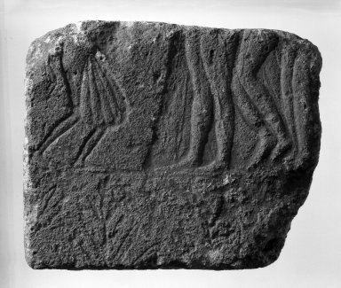 <em>Fragmentary Relief</em>, ca. 1400 B.C.E. Limestone, 9 1/4 x 11 1/4 x 2 5/16 in. (23.5 x 28.5 x 5.8 cm). Brooklyn Museum, Gift of Frederica Tchacos, 77.192. Creative Commons-BY (Photo: Brooklyn Museum, 77.192_negA_bw_IMLS.jpg)