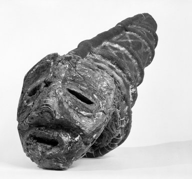 Chokwe. <em>Mask (Cikunza)</em>, late 19th-early 20th century. Bark cloth, fiber, pigment, resin, 26 x 10 x 10 3/4 in. (66.1 x 25.3 x 27.3 cm). Brooklyn Museum, Gift of Dr. John I. Dintenfass in honor of Nicole Dintenfass, 77.241. Creative Commons-BY (Photo: Brooklyn Museum, 77.241_bw.jpg)