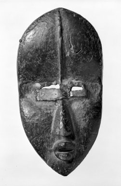 Dan. <em>Mask</em>, late 19th-early 20th century. Wood, metal, Other: 11 1/4 x 6 x 3 in. (28.6 x 15.2 x 7.6 cm). Brooklyn Museum, Gift of Marcia and John Friede, 77.243.4. Creative Commons-BY (Photo: Brooklyn Museum, 77.243.4_bw.jpg)