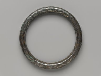 <em>Ring-Shaped Object</em>, 1100-256 B.C.E. Bronze, inlaid with silver, 4 5/8 in. (11.7 cm). Brooklyn Museum, Gift of Mr. and Mrs. Alastair B. Martin, the Guennol Collection, 77.54.2a-b. Creative Commons-BY (Photo: Brooklyn Museum, 77.54.2a-b_PS4.jpg)