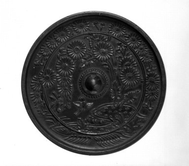 <em>Mirror</em>, 13th century. Cast bronze, 5/16 x 4 3/8 in. (0.8 x 11.1 cm). Brooklyn Museum, Designated Purchase Fund, 77.55.6. Creative Commons-BY (Photo: Brooklyn Museum, 77.55.6_bw.jpg)