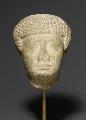 <em>Head in Short Wig</em>, ca. 1938-1875 B.C.E. Limestone, 4 1/2 x 3 x 3 1/2 in. (11.4 x 7.6 x 8.9 cm). Brooklyn Museum, Charles Edwin Wilbour Fund, 77.6. Creative Commons-BY (Photo: Brooklyn Museum, 77.6_PS2.jpg)