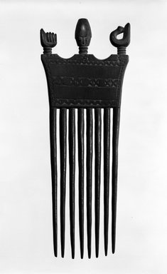 Asante. <em>Comb with Head, Sankofa Bird and Clenched Fist</em>, late 19th or early 20th century. Wood, height: 8 1/16 in. (20.5 cm). Brooklyn Museum, Gift of Mr. and Mrs. William W. Brill, 77.79.2. Creative Commons-BY (Photo: Brooklyn Museum, 77.79.2_bw.jpg)