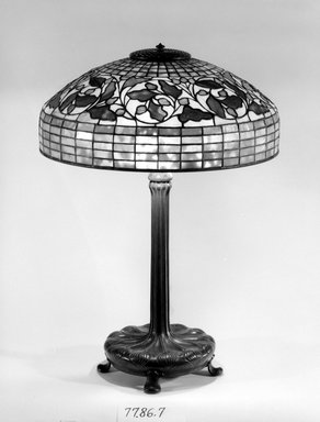 Tiffany Studios (1902-1932). <em>Table Lamp</em>, ca. 1906-1938. Bronze, glass, and lead, Overall: 26 x 18 1/8 x 18 1/8 in. (66 x 46 x 46 cm). Brooklyn Museum, Bequest of Carl Otto von Kienbusch, 77.86.7. Creative Commons-BY (Photo: Brooklyn Museum, 77.86.7_bw.jpg)
