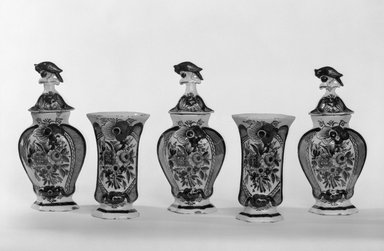 <em>One of Five-Piece vase garniture</em>, ca.1780. Ceramic, underglaze, and glaze, overall: 8 3/4 x 5 1/2 x 4 in. (22.2 x 14 x 10.2 cm). Brooklyn Museum, Gift of Nat Bass, 78.1.5. Creative Commons-BY (Photo: , 78.1.1-.5_bw.jpg)